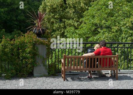 Romantic couple embracing, Skansen Open-Air Museum, Stockholm, Sweden - Stock Photo