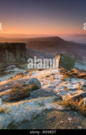 First Light on frost covered Curbar Edge in winter, near Calver, Peak District National Park, Derbyshire, England, - Stock Photo