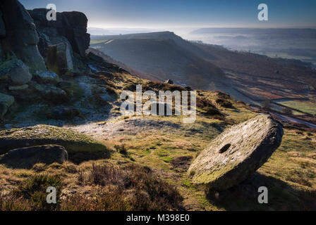 Abandoned Millstone on Curbar Edge in winter, Peak District National Park, Derbyshire, England, UK - Stock Photo
