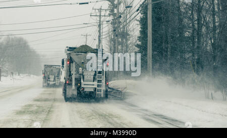 tandem snow plows remove snow/spread salt/sand from Riverside Street - Stock Photo