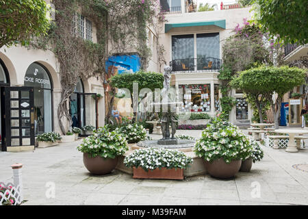 The Via Amore courtyard with its pricey shops in the shopping district off Worth Avenue in Palm Beach Florida. - Stock Photo