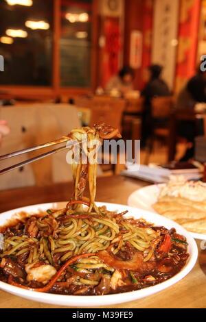 Close up of Jajangmyeon, Korean black bean sauce noodles at Korean restaurant, Busan, South Korea - Stock Photo