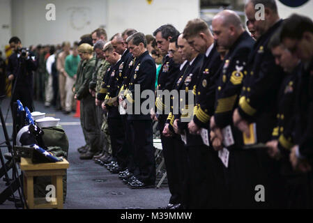171126-N-CL027-019 PHILIPPINE SEA (Nov. 26, 2017) Sailors gather for a memorial service in honor of Aviation Boatswain's - Stock Photo