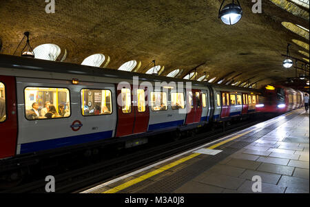 Underground (Tube) train car and another one streaking by, Baker Street Underground Station, London, England, United - Stock Photo