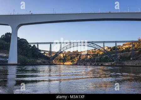 Railway bridge of Saint John over Douro River between Porto and Vila Nova de Gaia city in Portugal. View with old - Stock Photo