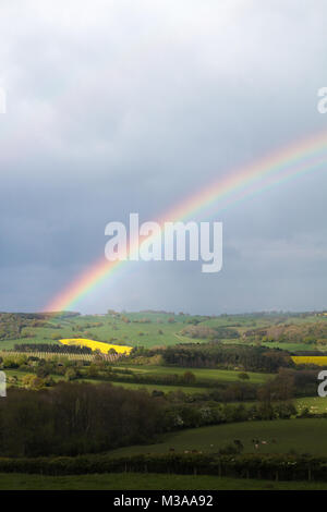 RAINBOW: A Rainbow arcs over the Herefordshire countryside, England, United Kingdom - Stock Photo