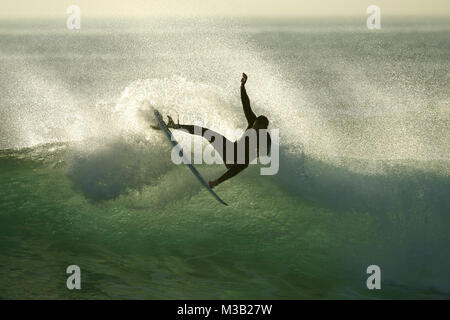San Diego, California, USA. 9th Feb, 2018. Surfer Johnny Noris surfs a wave at sunset at Windansea Beach in the - Stock Photo