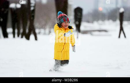 Chicago, USA. 9th Feb, 2018. A boy plays at Grant Park in Chicago, the United States, on Feb. 9, 2018. Credit: Wang - Stock Photo
