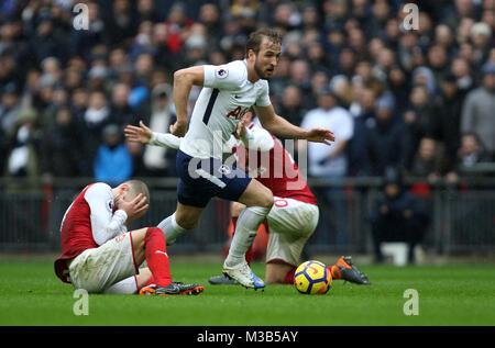 London, UK. 10th Feb, 2018. Jack Wilshere (A) Harry Kane (TH) Shkodran Mustafi (A) at the English Premier League - Stock Photo