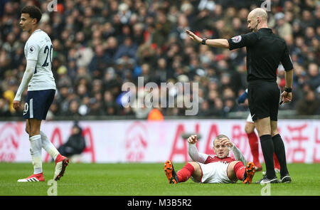 Jack Wilshere of Arsenal is fouled during the Premier League match between Tottenham Hotspur and Arsenal at Wembley - Stock Photo