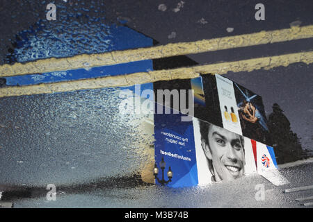 London, UK. 10 February 2018. Team GB images reflected in the rain at Piccadilly Circus. Roland Phillips/Alamy Live - Stock Photo