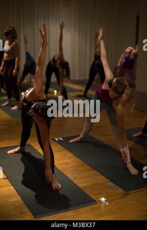 Blindfolded yoga class, London, England UK - Stock Photo