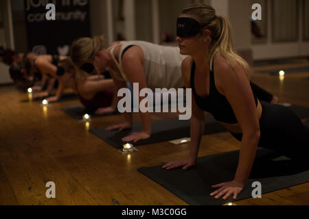 Blindfolded yoga class, London, England UK - Stock Photo