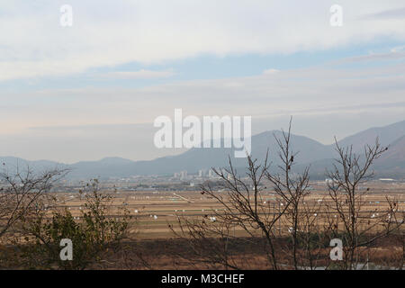 Gyeongju landscape with the mountains and paddy fields in autumn from Yangdong Folk Village, South Korea - Stock Photo