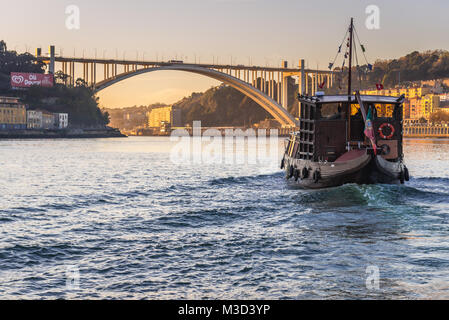 Tourist boat on the Douro River, view with Arrabida Bridge between Porto and Vila Nova de Gaia in Norte region of - Stock Photo