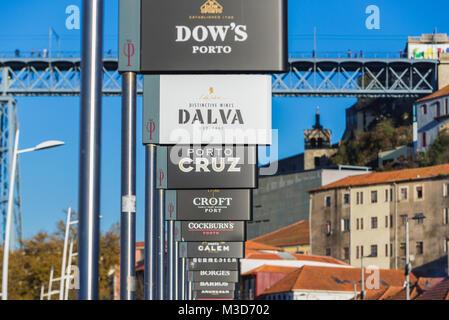 Pier of Port wine boats called Rabelo Boats on a Douro River in Vila Nova de Gaia city, Portugal - Stock Photo