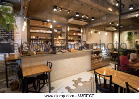 Blurred Of Beautiful Coffee Shop Interior In Loft Style Stock Photo