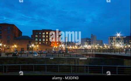 Liverpool, Merseyside, UK - February 20, 2009: Night scene of Albert Dock buildings and the skyline of Liverpool - Stock Photo