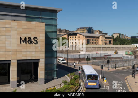 Corner of Marks & Spencer store in The Broadway shopping centre with traffic at road junction in city centre - Bradford, - Stock Photo