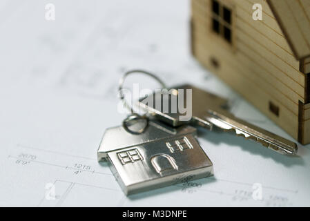 Key with house plan - Stock Photo