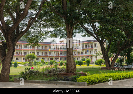 Coorg, India - October 29, 2013: Complex of small flats for nuns and monks at Namdroling Buddhist Monastery. Green - Stock Photo