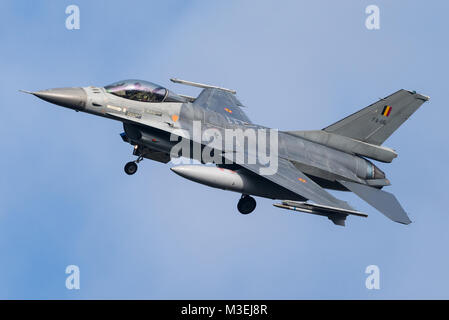 A F-16 fighter jet of the Belgian Air Force is ready to land at the Kleine Brogel Air Base in Belgium. - Stock Photo