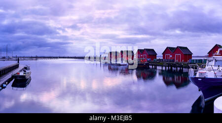 Sunrise at the Boltenhagen harbour, winter morning at the Baltic Sea - Stock Photo