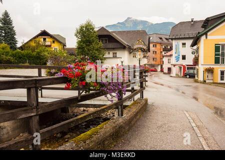 St. Gilgen, Austria - August 29, 2016: Empty street of alpine villge St. Gilgen is wet after rain. - Stock Photo