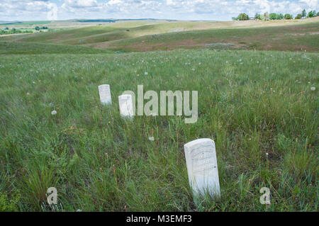 Crow Agency, MT - July 6, 2010: Markers show where US Soldiers fell during the Battle of Little Bighorn. - Stock Photo