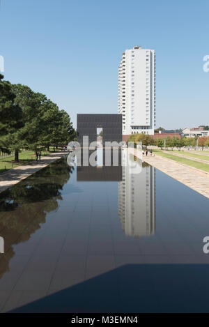 Oklahoma City, Oklahoma - October 14, 2015: Oklahoma City National Memorial reflecting pool and the 9:03 Gate of - Stock Photo