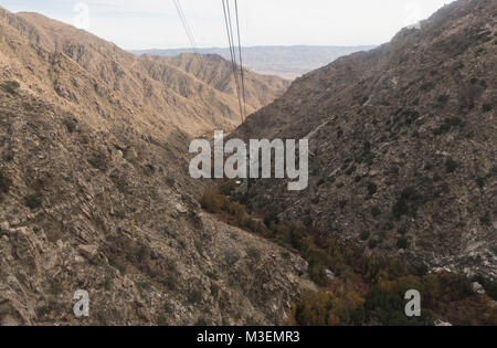 view from the gondola of the Palm Springs Aerial Tramway, the world's largest rotating tram car - Stock Photo