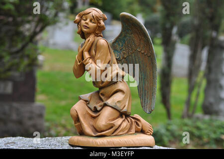 Angel Statue in a Catholic Cemetery - Stock Photo