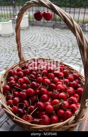 Cherries. Cherry. Organic cherries in basket on a farmer's market. Red cherry background. Fresh cherries texture. - Stock Photo