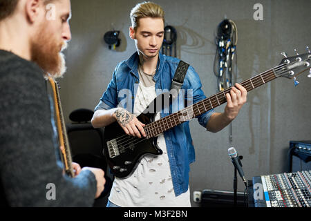 Sound director producing new album of young musician - Stock Photo