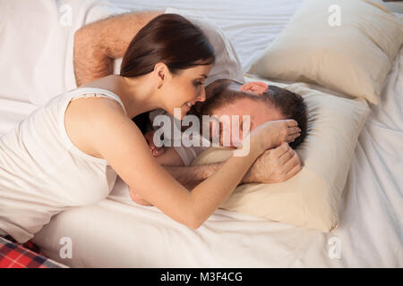 a woman wakes up in the morning, the family man - Stock Photo
