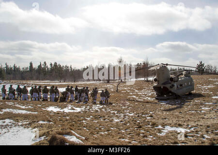 Soldiers line up ready to board a CH-47 Chinook helicopter from B Company, 3-10 General Support Aviation Battalion, - Stock Photo