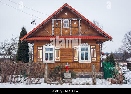 Wooden house in Soce village on so called The Land of Open Shutters trail, famous for traditional  architecture - Stock Photo