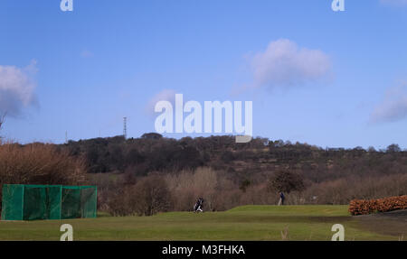 A photograph of a lone golfer on the Carrick Knowe Golf Course in Edinburgh, Scotland. - Stock Photo