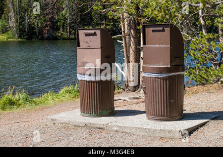 Bear proof garbage cans near Sylvan Lake.  Yellowstone National Park, Wyoming, USA - Stock Photo