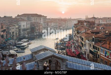 VENICE, ITALY - DECEMBER 23, 2017: Setting sun over the Grand Canal with Rialto bridge in Venice - Stock Photo