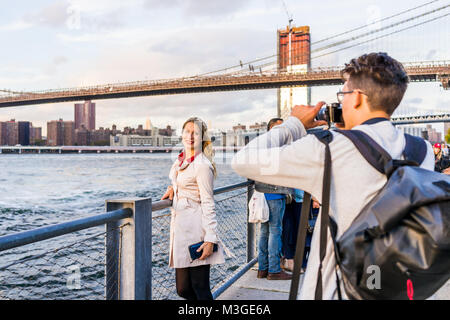 Brooklyn, USA - October 28, 2017: Outside outdoors in NYC New York City Brooklyn Bridge Park with young couple woman - Stock Photo