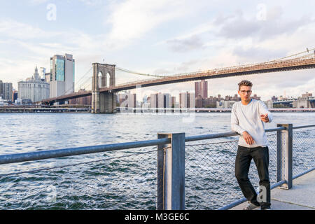 Brooklyn, USA - October 28, 2017: Outside outdoors in NYC New York City Brooklyn Bridge Park with young couple man - Stock Photo