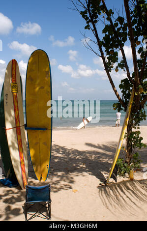 Offerings from the surfers on the beach of Kuta. Surfing lessons. Bali. Indonesia. Kuta is a coastal town in the - Stock Photo