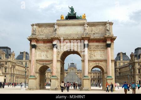 The Carrousel Triumphal Arch (Arc de Triomphe du Carrousel) in front of the Louvre - Paris, France - Stock Photo