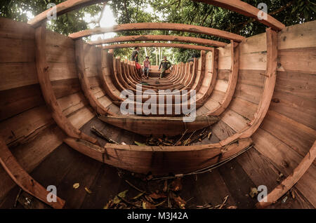 The traditional Sulawesi wooden fishing boat are being made by local fishermen. - Stock Photo