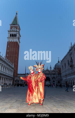 Venice, Italy. 11th February, 2018. Venice Carnival in St Marks Square Vicinity, People dressed and posing in Carnival - Stock Photo