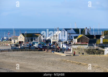 Lyme Regis, Dorset, UK.  11th February 2018.  UK Weather.  The beach and the Cobb Arms on a sunny morning at Lyme - Stock Photo