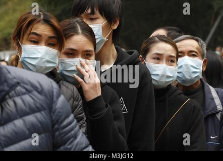 Hong Kong, CHINA. 11th Feb, 2018. Families of the victims of the fatal traffic accident queue up to pay respect - Stock Photo