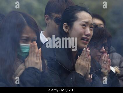 Hong Kong, CHINA. 11th Feb, 2018. Families of victims of the fatal traffic accident on February 10, 2018 pray for - Stock Photo