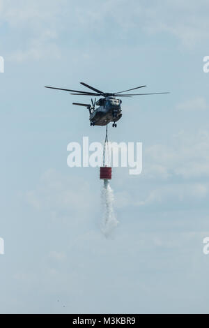 BERLIN, GERMANY - JUNE 03, 2016: Heavy-lift cargo helicopter Sikorsky CH-53 Sea Stallion of the German Army with equipment for fighting fires. Exhibition ILA Berlin Air Show 2016